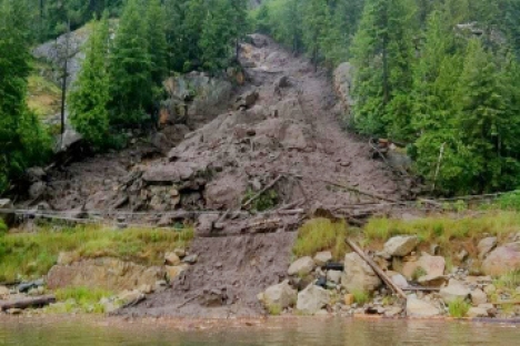 Crews have cleared part of the above slide near Syringa Creek to single-lane traffic. — Submitted photo