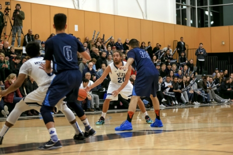 Mariners forward Eric D'Andrea pushes an entry pass in the key during the PACWEST Championship game against Capilano College. — Photo courtesy Vancouver sports photography