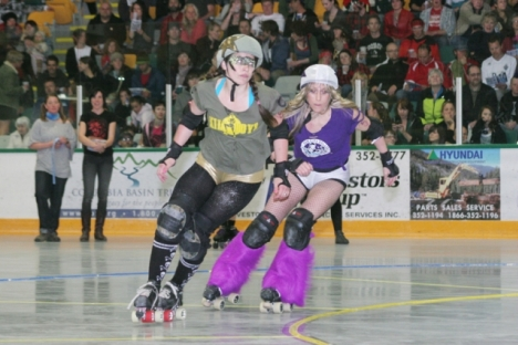 This Killjoys jammer gets hounded by Sweet Vengance of the Dam City Rollers during Saturday's Roller Derby stop at the NDCC Arena. — Bruce Fuhr photo